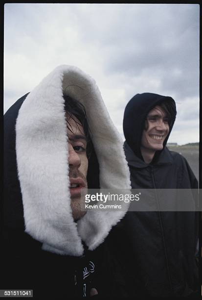 Guitarist Richey James Edwards and bassist Nicky Wire of Welsh alternative rock group the Manic Street Preachers on the beach at Swansea south Wales...
