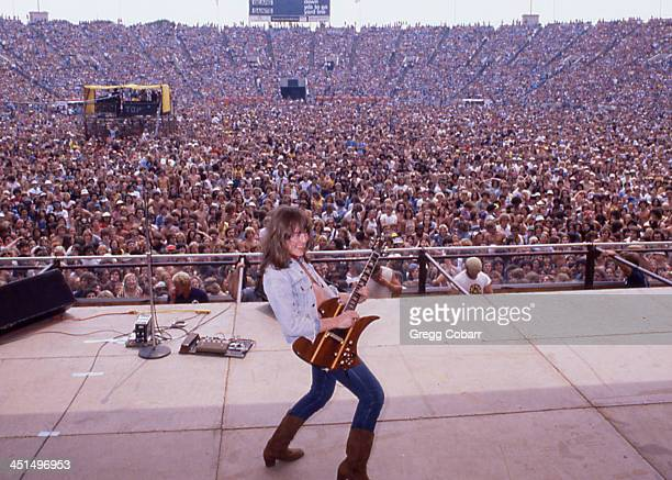 Guitarist Rick Derringer of the rock and roll group 'Derringer' performs onstage with his BC Rich Mockingbird Koa guitar for a crowd of 80000 people...