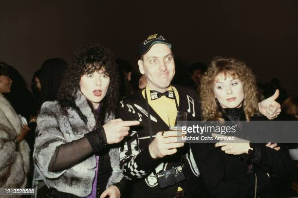 Guitarist Rick Nielsen of rock band Cheap Trick, with sisters Ann and Nancy Wilson of American rock band Heart, circa 1975.