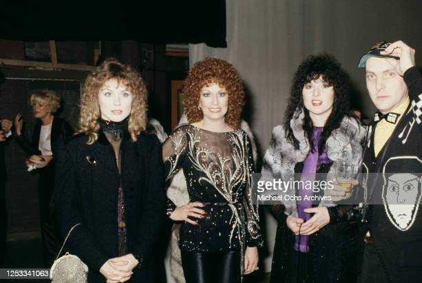 Guitarist Rick Nielsen of rock band Cheap Trick, with sisters Ann and Nancy Wilson of American rock band Heart, and country music singer Dottie West...