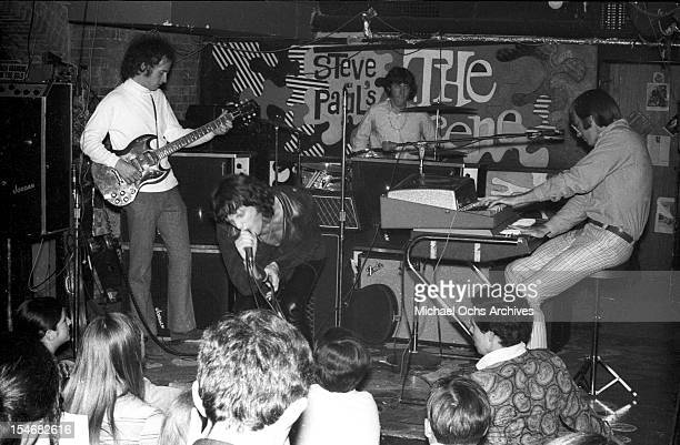 Guitarist Robby Krieger singer Jim Morrison drummer John Densmore and keyboardist Ray Manzarek of the rock and roll band 'The Doors' perform onstage...