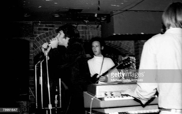 Guitarist Robby Krieger singer Jim Morrison drummer John Densmore and keyboardist Ray Manzarek of the rock and roll band The Doors perform onstage at...