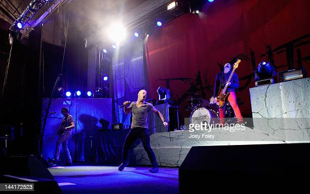 Guitarist Robin Diaz Vocalist Chris Daughtry and Bassist Josh Paul of Daughtry performs live at the Murat Theatre on May 10 2012 in Indianapolis...