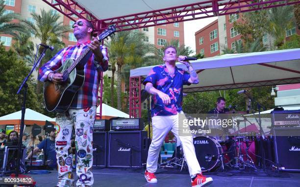 Guitarist Rodney Sheppard singer Mark McGrath and drummer Dean Butterworth of Sugar Ray perform at the Flamingo Go pool at Flamingo Las Vegas on June...