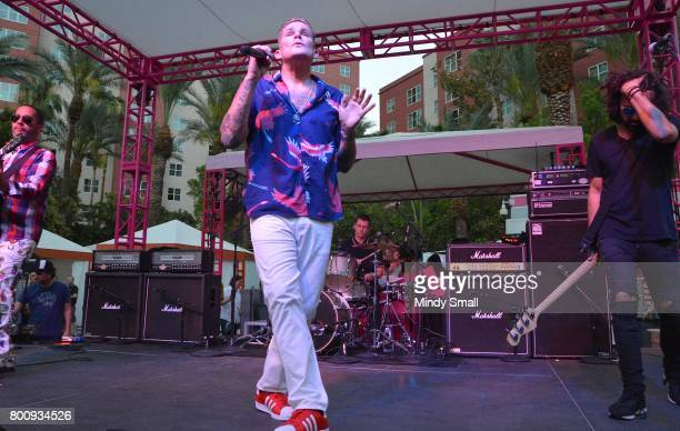Guitarist Rodney Sheppard singer Mark McGrath drummer Dean Butterworth and bassist Kristian Attard of Sugar Ray perform at the Flamingo Go pool at...