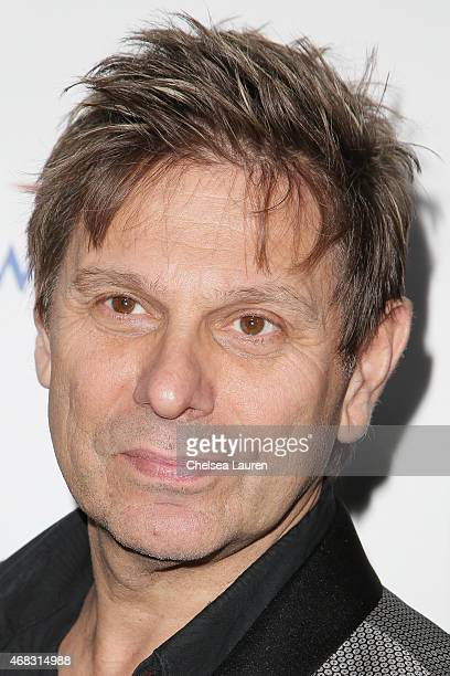 Guitarist Roger Andrew Taylor of Duran Duran arrives at the 10th anniversary of the David Lynch Foundation at The Ace Hotel Theater on April 1 2015...