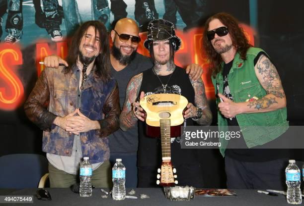 Guitarist Ron Bumblefoot Thal drummer Frank Ferrer guitarist Dj Ashba and keyboardist Dizzy Reed of Guns N' Roses attend a meetandgreet at Nellis Air...