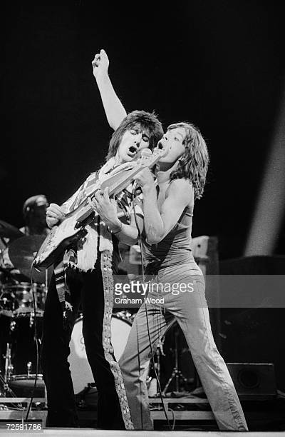 Guitarist Ron Wood and singer Mick Jagger of the Rolling Stones performing at Knebworth 21st August 1976