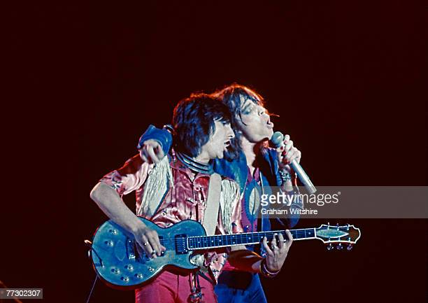 Guitarist Ron Wood and singer Mick Jagger of the Rolling Stones performing on stage circa 1976