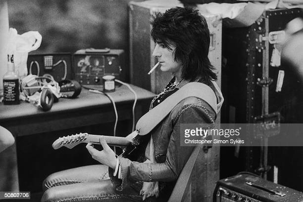 Guitarist Ron Wood tunes up before a concert during the Rolling Stones Tour of the Americas, 1975.