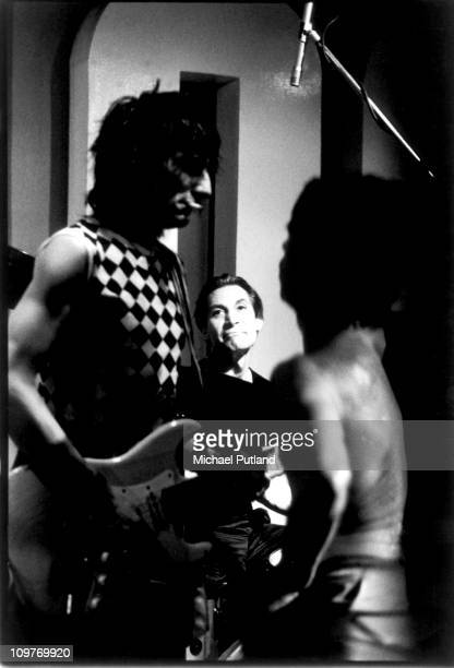 Guitarist Ronnie Wood and drummer Charlie Watts of the Rolling Stones performing on stage at the 100 Club in London England on May 30 1982