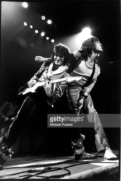 Guitarist Ronnie Wood and singer Mick Jagger of the Rolling Stones performing on stage at the Festhalle in Frankfurt, Germany in April 1976 as part...