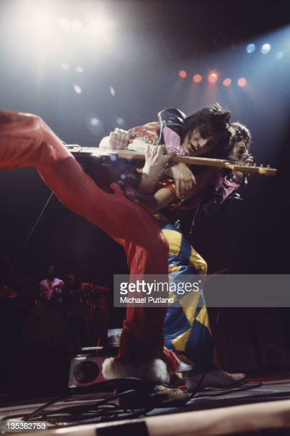 Guitarist Ronnie Wood and singer Mick Jagger of the Rolling Stones performing on stage at the Knebworth Fair in Hertfordshire 21st August 1976