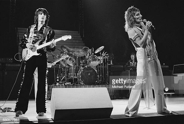Guitarist Ronnie Wood and singer Rod Stewart performing on stage with British rock group the Faces December 1974 In the background are bassist Tetsu...
