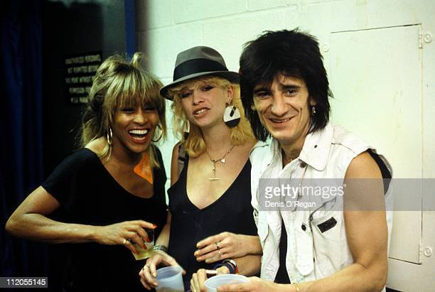 Guitarist Ronnie Wood of the Rolling Stones his wife Jo Wood and singer Tina Turner in New York City 1983