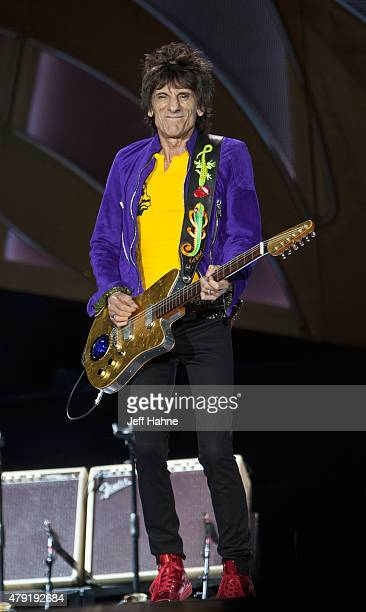 Guitarist Ronnie Wood of the Rolling Stones performs at Carter Finley Stadium on July 1 2015 in Raleigh North Carolina