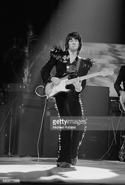 Guitarist Ronnie Wood performing on stage with British rock group the Faces December 1974