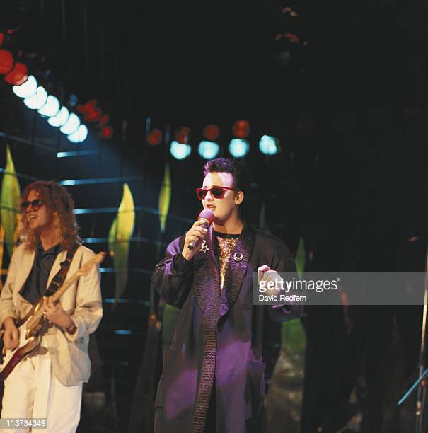 Guitarist Roy Hay and singer Boy George of Culture Club on stage during a live concert performance circa 1985