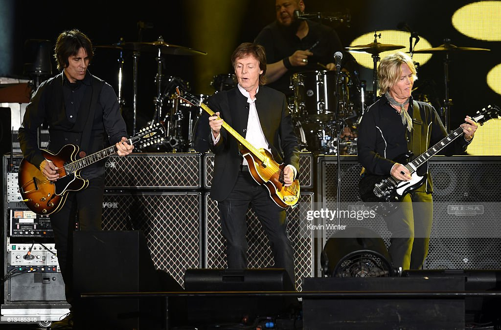 Guitarist Rusty Anderson, Sir Paul McCartney and Brian Ray perform onstage during Desert Trip at the Empire Polo Field on October 8, 2016 in Indio, California.