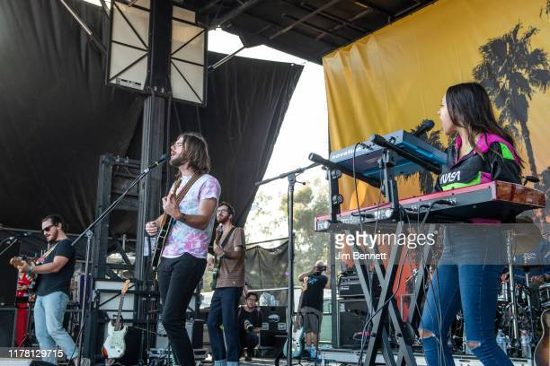 Guitarist Sam Cooper lead vocalist and guitarist Matt Cooper bassist Michael Byrnes and keyboardist Jackie Miclau of Mt Joy perform live during Ohana...