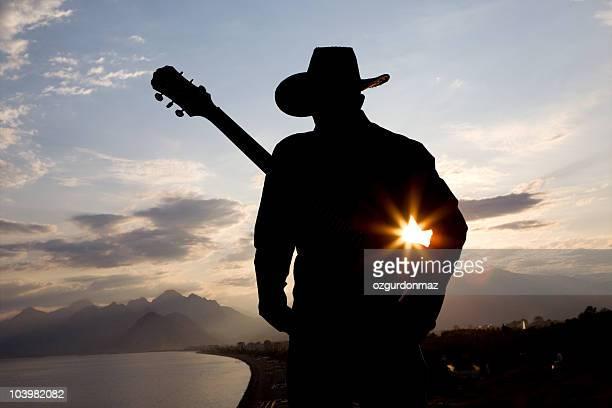 guitarrista serie - cowboy hat fotografías e imágenes de stock