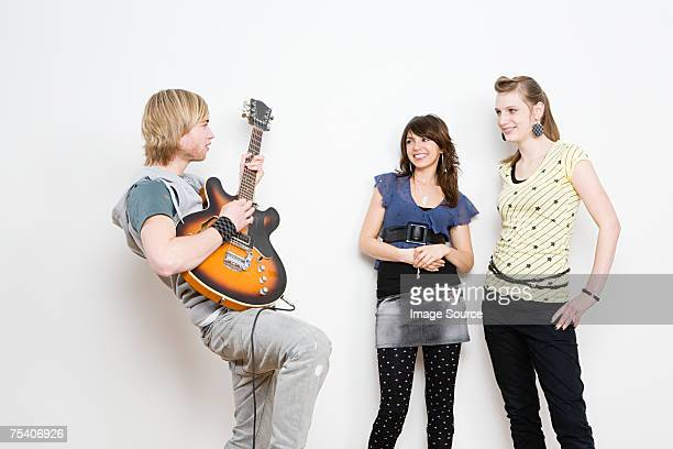 Guitarist showing off to young women