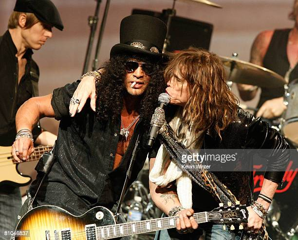 Guitarist Slash and singer Steven Tyler perform during the 4th Annual MusiCares Map Fund Benefit Concert at The Music Box at Fonda Theater on May 9,...