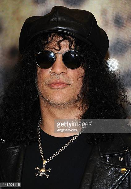 Guitarist Slash attends the unveiling of the 2012 Gibson Guitartown new round of guitars on The Sunset Strip at Hornburg Jaguar on March 12 2012 in...