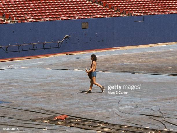 Guitarist Slash of the rock group 'Guns n' Roses' walks the stadium during soundcheck as they get ready to open for Aerosmith and Deep Purple as they...