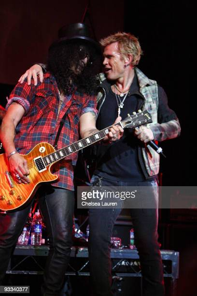 Guitarist Slash of Velvet Revolver and singer Billy Idol perform at the Los Angeles Youth Network benefit rock concert at Avalon on November 22 2009...