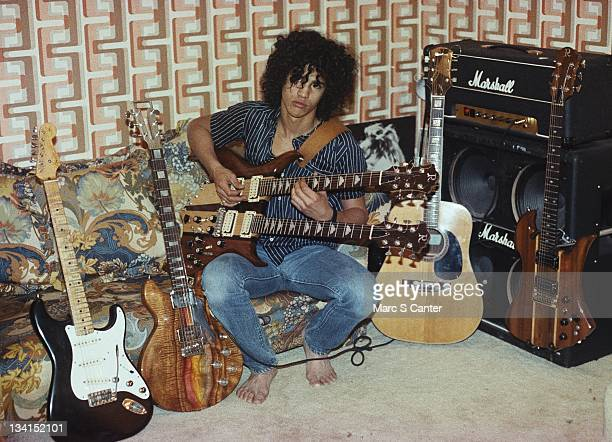 Guitarist Slash poses for a portrait in his bedroom with his guitars and a Marshall halfstack amplifier in 1983 in Los Angeles California