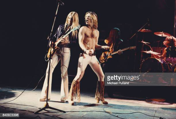 Guitarist Stanley Knight and lead singer Jim 'Dandy' Mangrum of American southern rock group Black Oak Arkansas perform on stage 1974