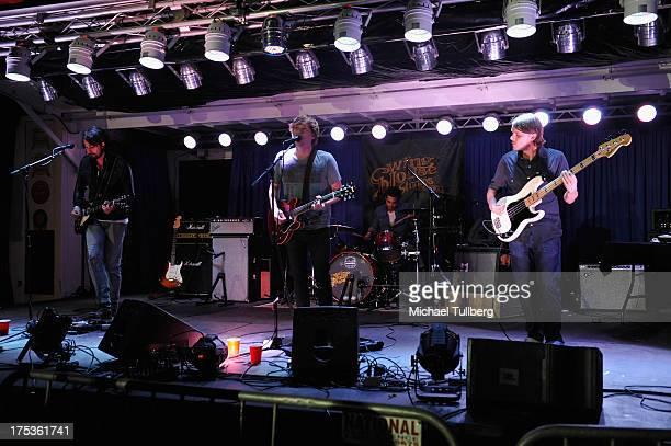 Guitarist Stephen Johnson singer/guitarist Graham Bockmiller drummer Rich Carillo and bassist Paul Hiller of Great White Buffalo perform live on the...