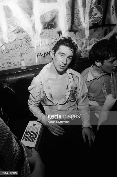 Guitarist Steve Diggle and drummer John Maher English punk band The Buzzcocks cool off backstage at the Marquee Club London 4th August 1977