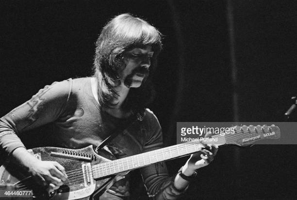 Guitarist Steve Hackett playing a a Coral electric sitar during a performance with English progressive rock group Genesis at the Theatre Royal Drury...
