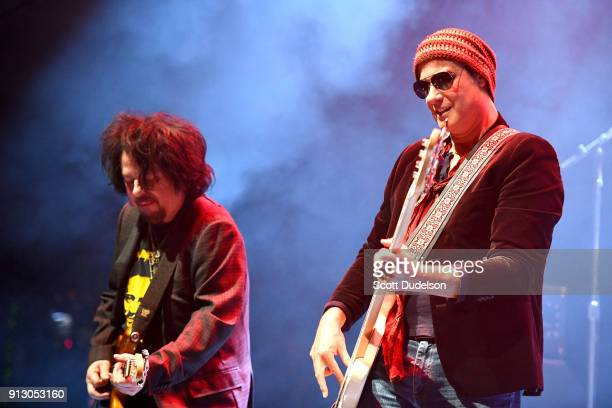 Guitarist Steve Lukather of the band Toto and bass player Robert DeLeo of Stone Temple Pilots performs onstage with Kings of Chaos at the Adopt the...