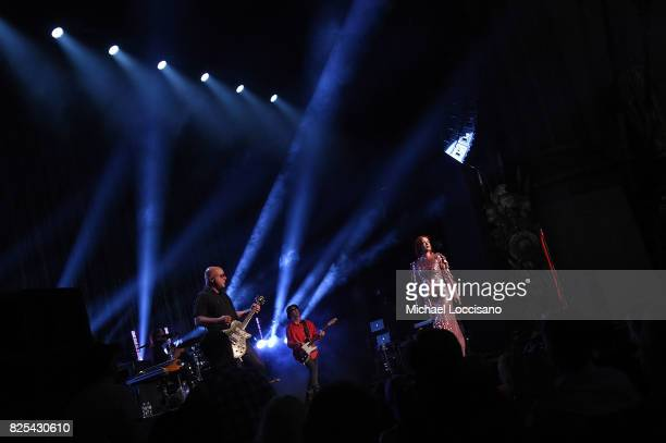 Guitarist Steve Marker bassist Eric Avery and singer Shirley Manson of Garbage perform during The Rage And Rapture Tour at The Beacon Theatre on...