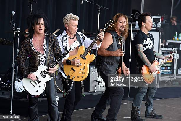 Guitarist Steve Stevens singer Billy Idol bassist Stephen McGrath and guitarist Billy Morrison perform at the Lands End Stage during day 2 of the...