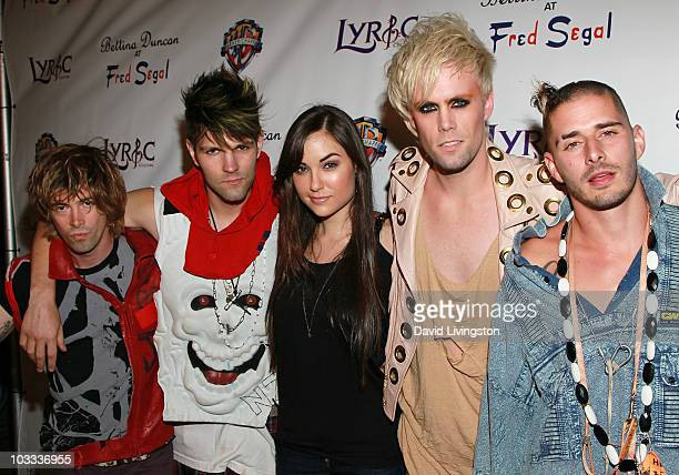 Guitarist Stevy Pyne drummer Dan Crean of Semi Precious Weapons actress Sasha Grey and singer Justin Tranter and bass guitarist Cole Whittle of Semi...