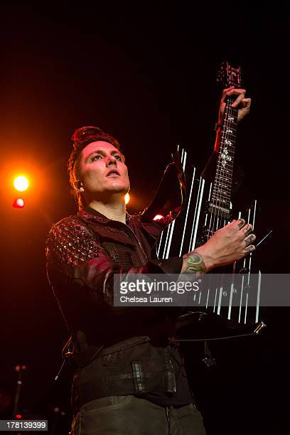 Guitarist Synyster Gates of Avenged Sevenfold performs at a free show celebrating the release of 'Hail To The King' at Hollywood Palladium on August...