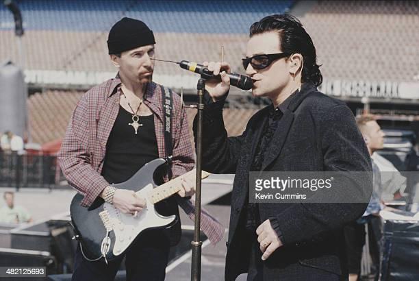Guitarist The Edge and singer Bono of Irish rock group U2 at a soundcheck circa 1992