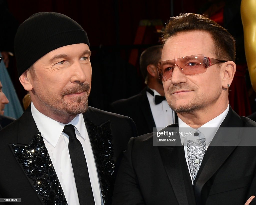 Guitarist The Edge (L) and singer Bono of U2 attend the Oscars held at Hollywood & Highland Center on March 2, 2014 in Hollywood, California.