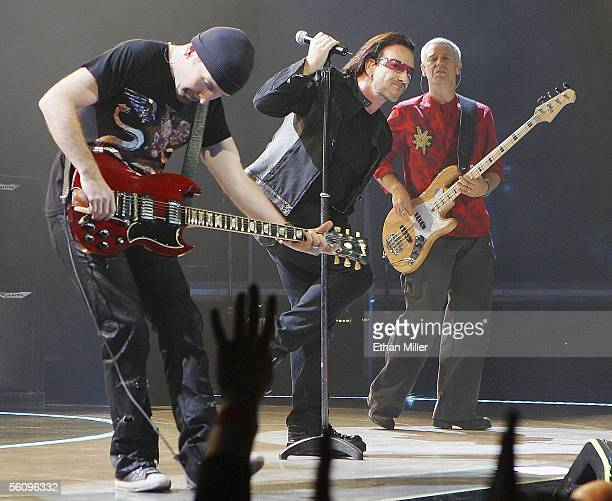 U2 guitarist The Edge singer Bono and bassist Adam Clayton perform during the first of two soldout shows of their 'Vertigo' tour at the MGM Grand...