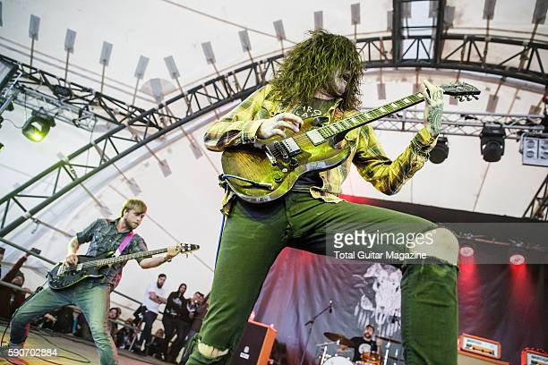 Guitarist Thomas Erak and bassist Tim Ward of American hard rock group The Fall Of Troy performing live on stage at ArcTanGent Festival in Somerset...