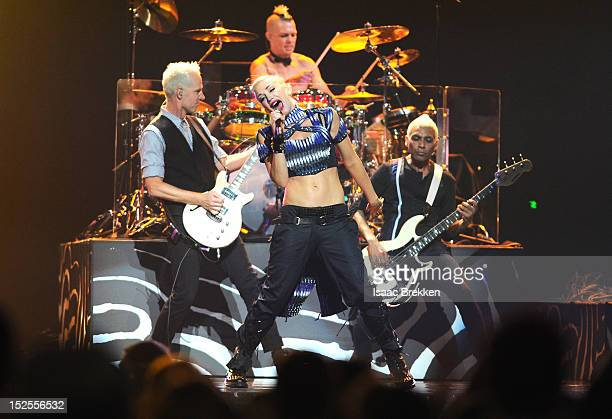 Guitarist Tom Dumont drummer Adrian Young singer Gwen Stefani and bassist Tony Kanal of No Doubt perform onstage during the 2012 iHeartRadio Music...