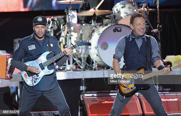 Guitarist Tom Morello and singer Bruce Springsteen perform onstage at the Capital One JamFest during the NCAA March Madness Music Festival Day 3 at...