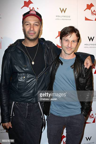 Guitarist Tom Morello of Street Sweeper Social Club and actor Breckin Meyer arrive at the Los Angeles Youth Network benefit concerts at Avalon on...