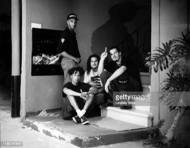 Guitarist Tom Morello vocalist Zack de la Rocha drummer Brad Wilk and bassist Tim Commerford his forefinger raised seated on steps outside RATM home...