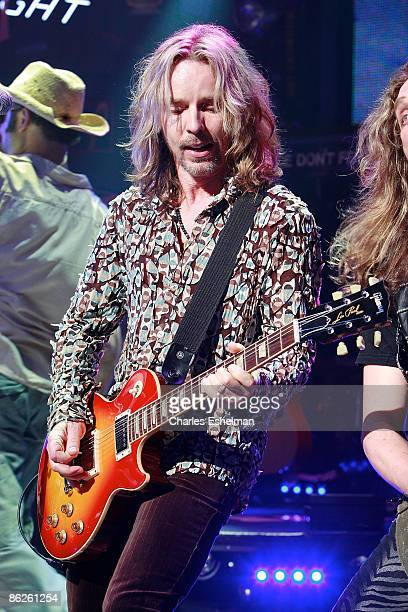 Guitarist Tommy Shaw performs during the Rock of Ages curtain call at the Brooks Atkinson Theatre on April 27 2009 in New York City