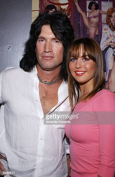 KISS guitarist Tommy Thayer and his girlfriend Amber Peek arrive at the record release party for Gene Simmons' 'Asshole' on April 22 2004 at the Key...